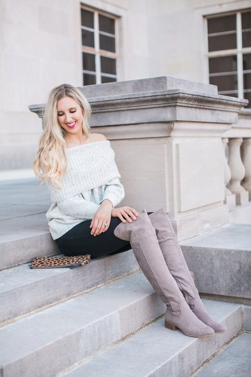 blush and camo, over the shoulder sweater, over the knee boots, black jeans, blonde hair, clare v, clare v clutch
